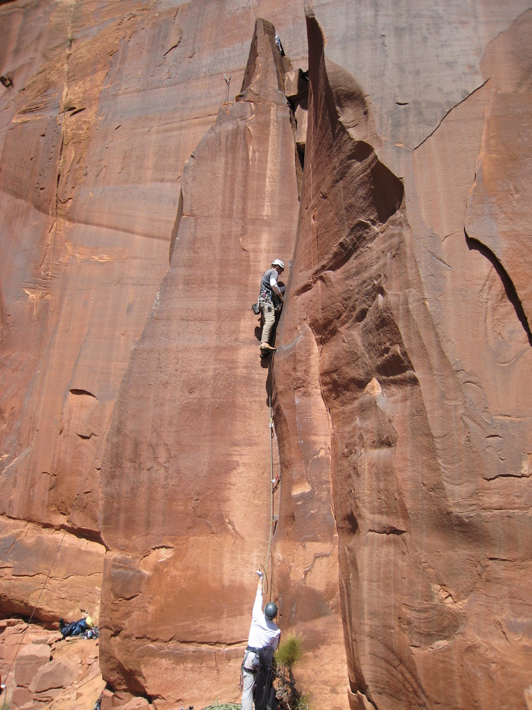Matt L. leads an unnamed 5.10 offwidth, left of Wavy Gravy, on Scarface Cliff
